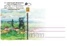 Pieczątka i pocztówki z G2 w tle